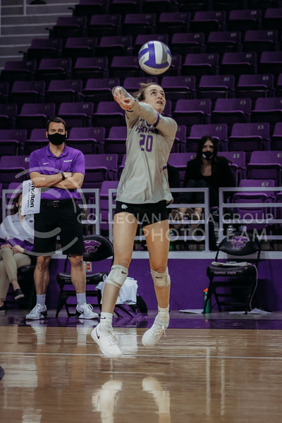 Freshman libero Mackenzie Morris passes the ball up during the March 28, 2021 spring volleyball game against Wayne State at Bramlage Coliseum. (Sophie Osborn | Collegian Media Group)