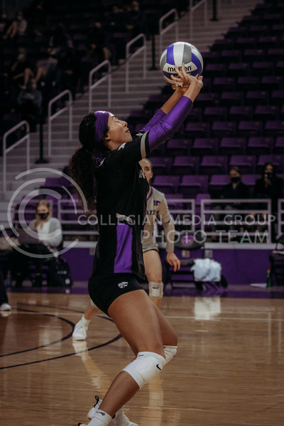 Sophomore Teana Adams-Kaonohi sets the ball up during the March 28, 2021 spring volleyball game against Wayne State at Bramlage Coliseum. (Sophie Osborn | Collegian Media Group)