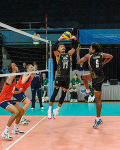 Jump set by Charoensuk (Thailand).  Nilsawai (Thailand) preparing to spike and Kadirkhanov and Gorbatkov (Kazakhstan) preparing to block.