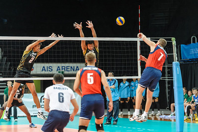 Spike by Gorbatkov (Kazakhstan) with blocks by Vaenprada and Tabwises (Thailand)