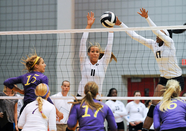 Lauren Teknip (11) and Jasmine Eaton (17) jump up to block a spike during the Bulldog Invitational on Friday, Aug. 30, 2013, in Athens, Ga.  (Photos by Sean Taylor)