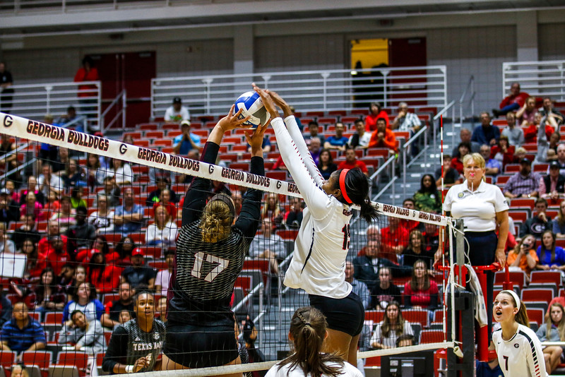 Georgia's Majesti Bass (19) goes for the block - UGA Volleyball Team -  (Photo by John Paul Van Wert / Georgia Sports Communication)