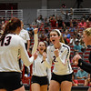 Memebrs of the Georgia volleball team celebrate scoring during the Bulldogs' game with UNC Asheville at the Ramsey Center in Athens, Ga., on Friday, August 26, 2016. (Photo by David Barnes)