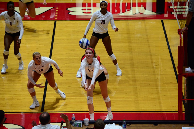 Lady Bulldogs Meghan Donovan (22), Cassidy Anderson (20), Majesti Bass (19), and T'ara Ceasar (1) during a UGA volleyball team match at the Ramsey Student Center in Athens, GA.  (Photo by Caitlyn Tam / Georgia Sports Communications)