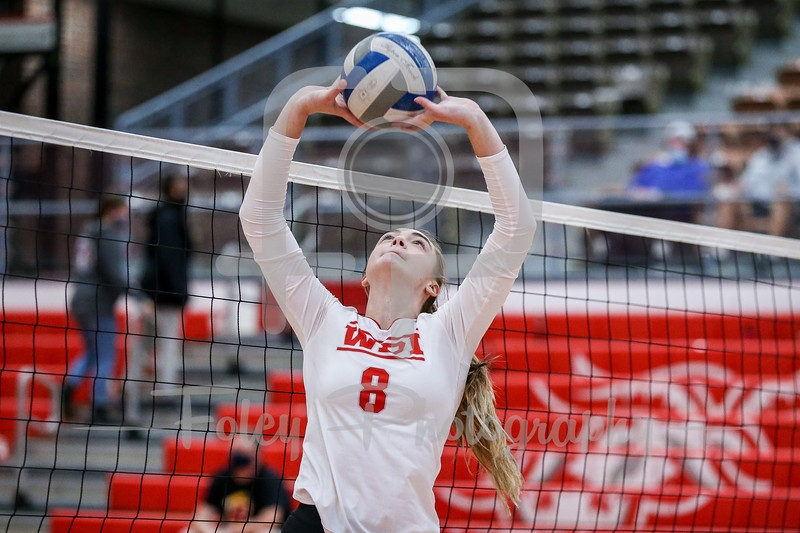 Sep. 01, 2021; Worcester, Massachusetts, USA; WPI Engineers setter Lily Eldridge (8) during a non conference matchup between Regis College and WPI. The Engineers won 3-0 over the Pride at Harrington Gymnasium. Photo by Foley-Photography.