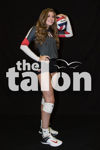 Varsity Volleyball takes pictures for the gym banners. (Campbell Wilmot/The Talon News)
