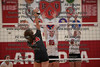 Arcadia's Morgan Squire (15) and Tori Green (9) block this spike attempt by St. Joe's Morgan Grahl (24).