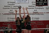 Ottoville's Taylor Beining (14) tips the ball over the hands of Arlington's Carlee Simon (11) and Abbie Sheets (18).