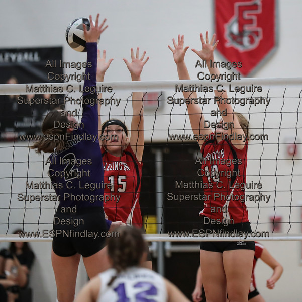 Ada's Kirsten Poling (2) gets a point killing the ball past Arlington's Jeri Bower (15) and Abbie Sheets (18).