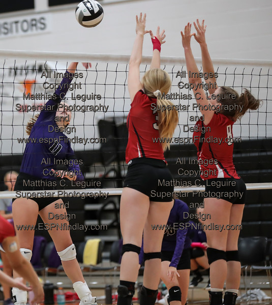 Ada's Megan Light (11) gets a point killing the ball past Arlington's Hailey Essinger (3) and Lindsay Dodds (8).
