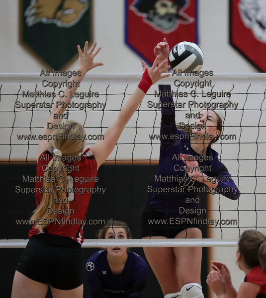 Arlington's (3) gets a point by blocking the spike from Ada's Megan Light (11).