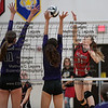 Arlington's Carlee Simon (11) gets a point killing the ball past Ada's Megan Light (11) and Aubrey Madison (6).