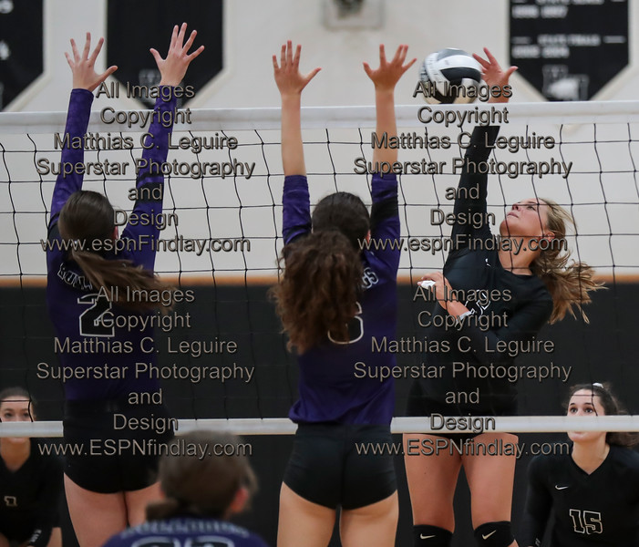 HN's Megan Miller (6) spikes the ball at Ada's Kirsten Poling (2) and Aubrey Madison (6).