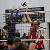 Arlington's Abbie Sheets (18) tips the ball over the block attempt of Ada's Kirsten Poling (2) for a point.