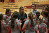 HL's head coach Carrie Weaver talks with her team during a timeout against Arlington.