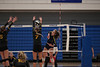 OG's Erica Annesser (13) gets a kill spiking the ball right through the hands of Fairview's Riley Mealer (7).