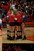 McComb starters huddle up before the start of the first game vs. Ayersville in Elida.