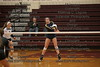 OG's Carly Alt (12) elevates slightly as she recieves a serve, bumping the ball up to the setter against Coldwater.
