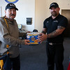 Choice Fitness General Manager Dave Mansfield is involved in a number of charitable organizations, raising money for everything from cystic fibrosis research to suicide prevention. Friday in his office he talked about what he does for the people and communities in the Merrimack Valley. He has three fundraisers in the lobby of Choice Fitness that he started on Wednesday. They are a food drive, clothing drive and sleeping bag drive. Stephen Zabierek of Chelmsford donated som macaroni and cheese to Mansfield just before working on on Friday. SUN/JOHN LOVE