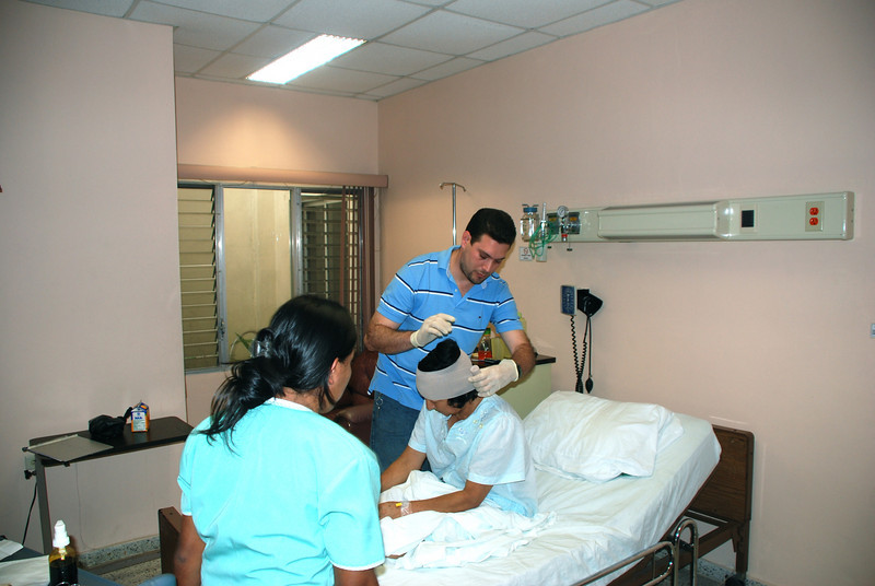 Roberto replacing headwrap at the private hospital in Comayagua,  2009