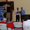 Giving a presentatin in Comayagua on Low back pain.  Oscar presents me with a carved name plate for my desk.