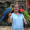 Kim with Macaws at the Macaw Mountain Bird Park and Nature Reserve (Parque de Aves y Reserva Natural) at Ruinas de Copan.