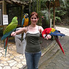 Cinthia with Macaws at the Macaw Mountain Bird Park and Nature Reserve (Parque de Aves y Reserva Natural) at Ruinas de Copan.