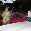 Osly Vasquez´s Camarro at a car show with Alan, Mauricio Perdomo behind the wheel and Osly smiling.  Tegucigalpa, 2007