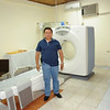 Ronny by the CT scanner at the imaging clinic in Juticalpa, Olancho, Honduras