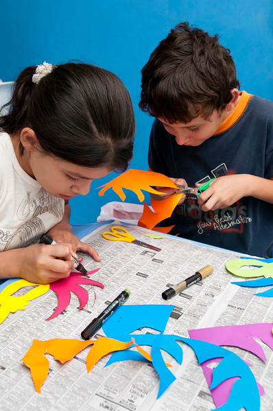 Children concentrate on an art project.