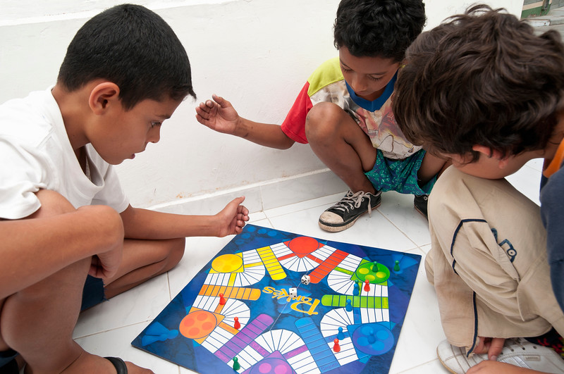 Boys play a board game.