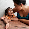 Volunteer shares a moment with a young girl.