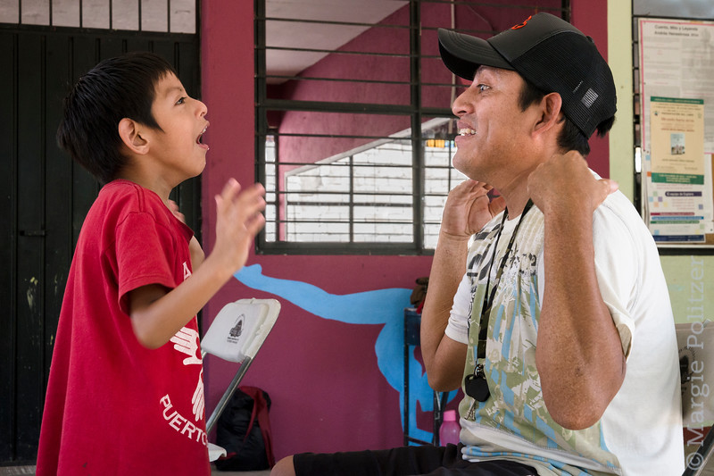 Father engages with deaf, mentally challenged son.