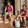 Women draw water from public spigot before running water was provided to houses.
