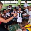 Volunteer teaches English to children at a Muslim school.