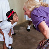 Volunteer plays a game with a special needs student.