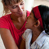 Volunteer shares a moment with a student.
