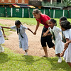 Volunteer plays with girls during recess at the Sulaimanya Muslim School in Galle, Sri Lanka