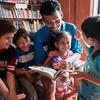 Neighborhood man reads to children
