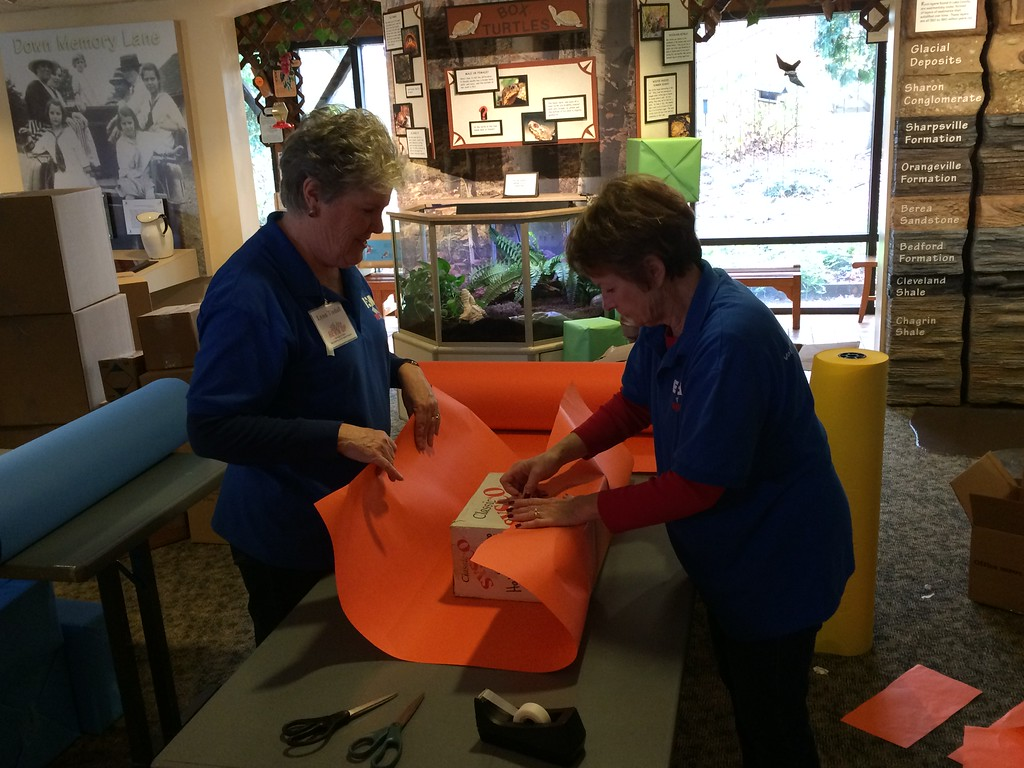 ". Chad Felton � The News-Herald <br> REV\'d UP volunteers Lynn Tindall, left, and Kathy Potkalitsky wraps a ""fake present\"" at Penitentiary Glen Reservation in Kirtland on Nov. 8."