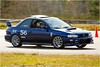 Doug and Tasha's 2000 Impreza 2.5RS : Doug and Tasha race their 2000 Subaru Impreza 2.5RS in SCCA's ST class. This car has RaceComp shocks with Vorshlag camber plates. They Beta tested our first production set of Subaru GC chassis plates in 2008.