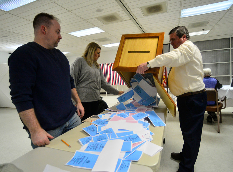 KRISTOPHER RADDER — BRATTLEBORO REFORMER<br /> Richard Johnson, the moderator for Hinsdale, N.H., dumps the primary ballots onto the table at the Millstream Community Center, in Hinsdale, N.H., as Megan Kondrat, of Hinsdale, N.H., and Mike Darcy, of Hinsdale, N.H., watches before they start to organize the pile after the closing of the polls during the New Hampshire presidential primary elections on Tuesday, Feb. 11, 2020.