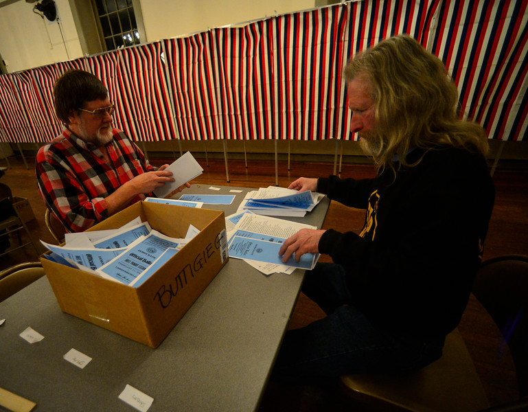 KRISTOPHER RADDER — BRATTLEBORO REFORMER<br /> Brad Roscoe, of Chesterfield, N.H., and Jeff Scott, of Chesterfield, N.H., count the ballots for Democratic presidential candidate former South Bend, Ind., Mayor Pete Buttigieg after the closing of the polls during the New Hampshire presidential primary elections on Tuesday, Feb. 11, 2020.