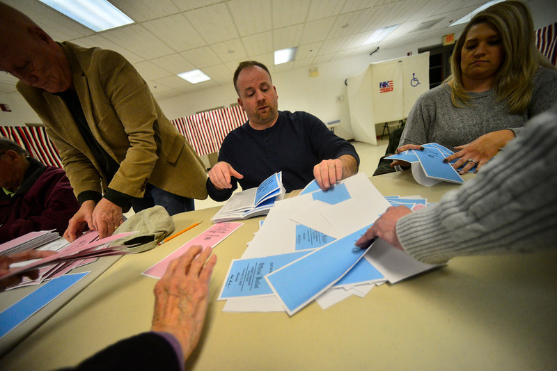 KRISTOPHER RADDER — BRATTLEBORO REFORMER<br /> Mike Darcy, of Hinsdale, N.H., puts the primary ballots into piles before they start to count the votes at the Millstream Community Center, in Hinsdale, N.H., after the closing of the polls during the New Hampshire presidential primary elections on Tuesday, Feb. 11, 2020.
