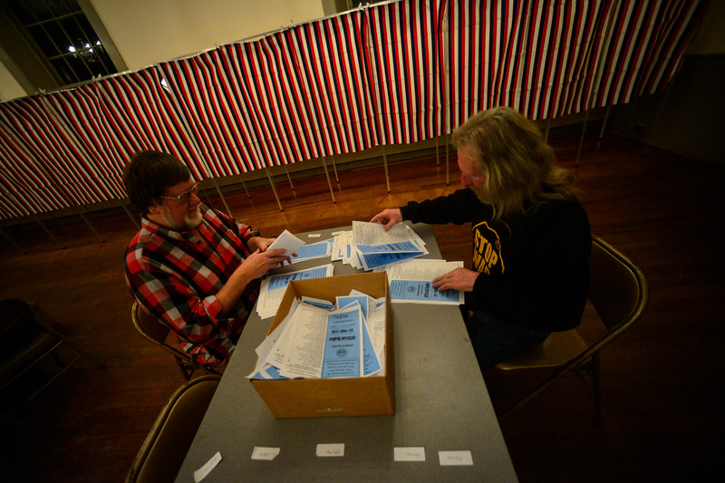 KRISTOPHER RADDER — BRATTLEBORO REFORMER<br /> People count votes by hand at Chesterfield and Hinsdale after the closing of the polls during the New Hampshire presidential primary elections on Tuesday, Feb. 11, 2020.