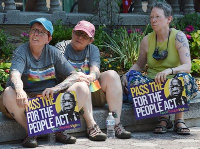 Supporters of voting rights legislation before the U.S. Congress, listen to speakers at this rally in Wilmington, DE.