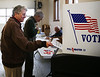HOLLY PELCZYNSKI - BENNINGTON BANNER Christie Ley of Shaftsbury hands in her ballot at the Shaftsbury Fire Department in Tuesday afternoon.