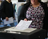 HOLLY PELCZYNSKI - BENNINGTON BANNER A voter hands in their ballot on Tuesday at a local polling center at the Bennington Fire Department in Bennington.