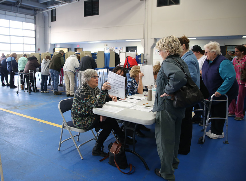 HOLLY PELCZYNSKI - BENNINGTON BANNER Voter turnout reached record numbers in Bennington as residents head to the polls to vote on Tuesday morning at the Bennington Fire Department.