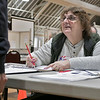 Tuesday the candidates were out holding signs at the polls in Fitchburg, Nov. 5, 2019. Checking in a voter is Inspector Ann Bastien. SENTINEL & ENTERPRISE/JOHN LOVE